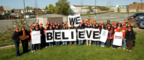 Campbell's workers holding sign saying we believe