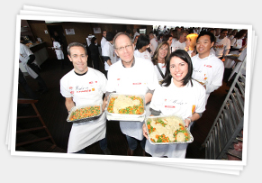 volunteer chefs holding food