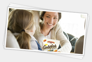 Mother and daughter eating Goldfish crackers